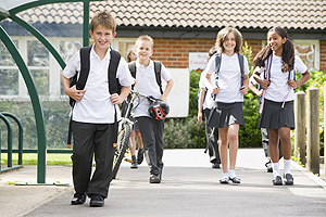 4 children walking home from school