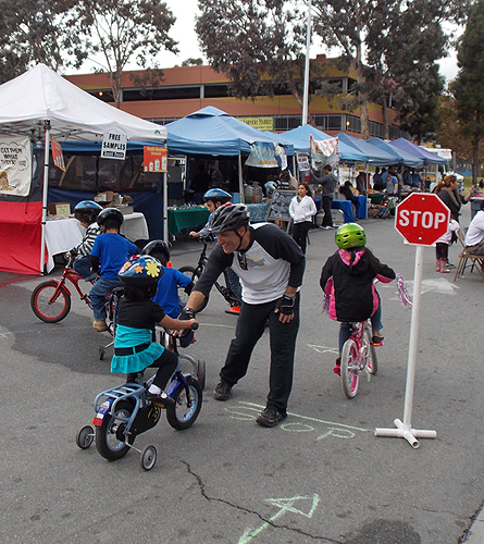 Teaching children how to properly stop their bikes.